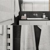 Полотенце, халат и тортик в спальне.