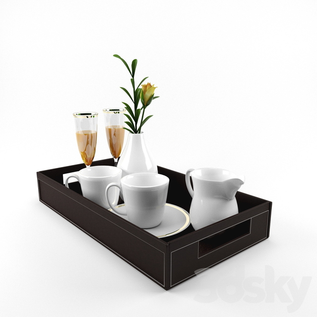 A tray of dishes and a flower